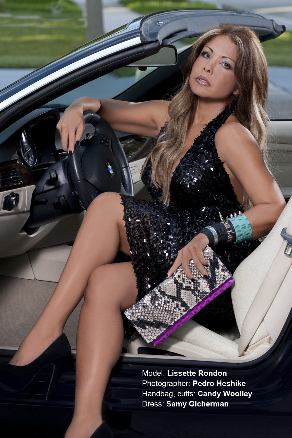 Lissette Rondon sporting a Candy Woolley elongated python clutch