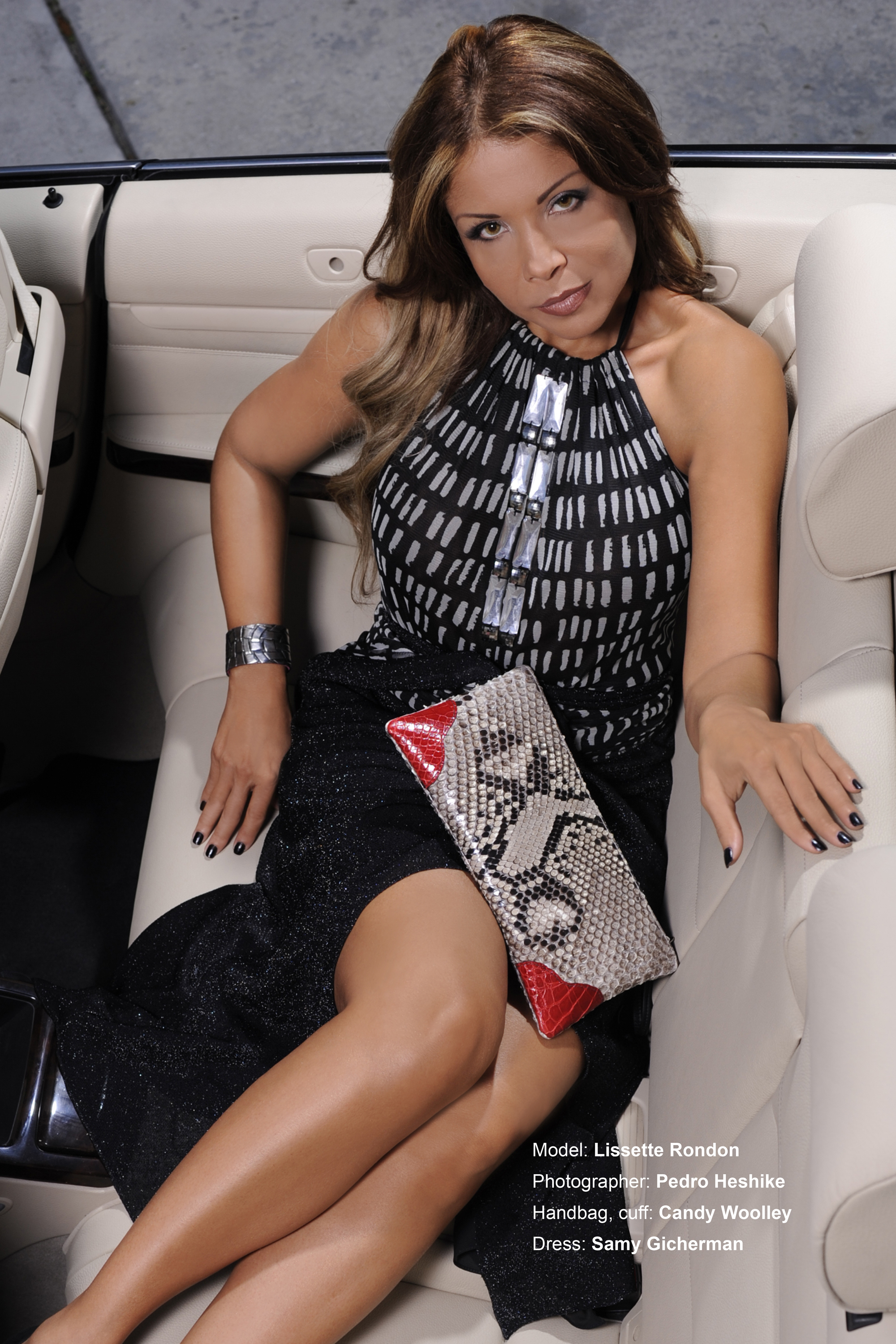 Lissette Rondon with a Candy Woolley two toned python & alligator clutch