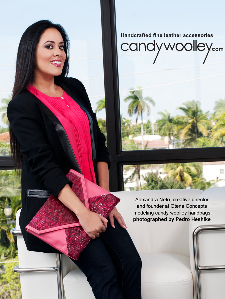 Alexandra Neto with a Candy Woolley Anouk raspberry leather clutch